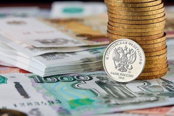 Курс рубля усилил рост и нацелен на отметку 64 за доллар