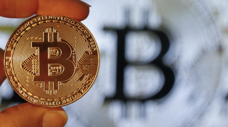 Агенство Weiss Ratings повысило оценку биткоина